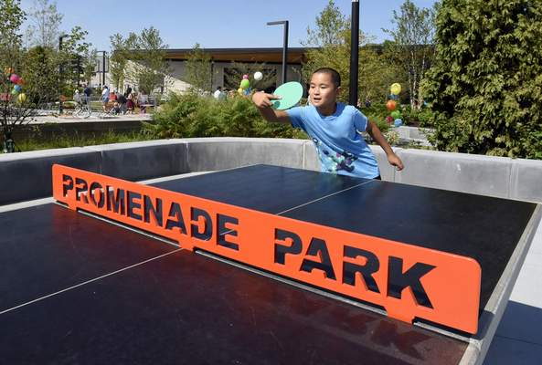 Yufan Dong, 10, hits the ballin a game of table tennis while enjoying the park's amenities  Saturday. The grand opening ends today with Nature Day events.