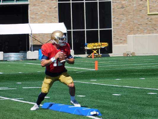 Notre Dame quarterback Ian Book was voted one of seven 2019 Irish captains by his teammates Saturday.