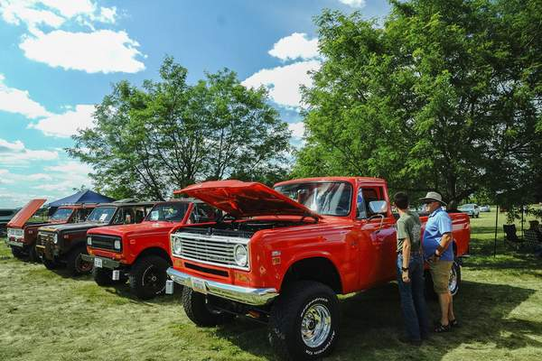 Photos by Mike Moore | The Journal Gazette Paul Thieme, left, and Ron Barker check out a 1974 International 200 series pickup Saturday while attending the Harvester Homecoming at the Scout Park Conference Center on Meyer Road.