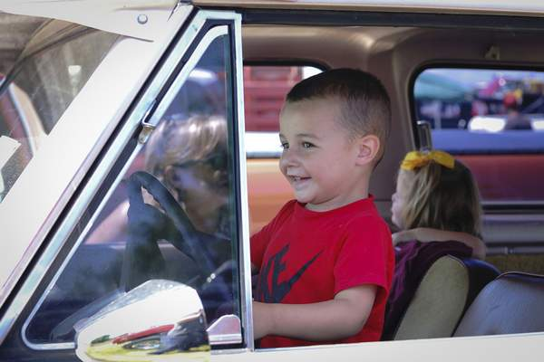 Pete Taulbee, 3, pretends he's driving his cousins around in his grandfather's 1977 Scout Traveler at the Scout Park Conference Center on Meyer Road on Saturday.