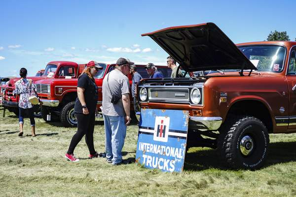 Mike Moore | The Journal Gazette  Guests check out International Harvester trucks from all over the country while attending Harvester Homecoming at the Scout Park Conference Center on Meyer Road on Saturday.