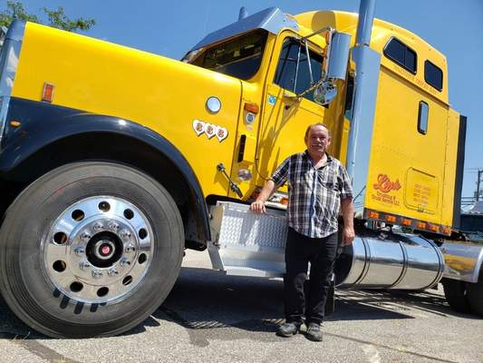 MATTHEW LEBLANC | The Journal Gazette  Troy Link of Homer, Michigan, bought a 1999 International Harvester 9300 years ago and restored it. He now uses it to make deliveries throughout the Midwest. The truck was on display Saturday at Harvester Homecoming in Fort Wayne.