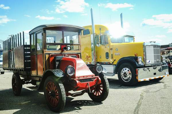 Photos by Mike Moore | The Journal Gazette A 1919 Model F, left, and 1993 International 9300 semi truck were two of the vehicles on display at the Scout Park Conference Center on Saturday for the Harvester Homecoming.