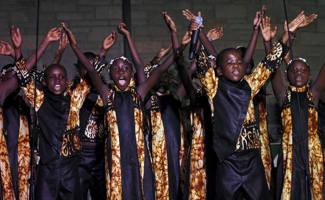 Rachel Von Stroup | The Journal Gazette  Children ages 8to 11 perform in the African Children's Choir performance at Holy Cross Lutheran Church on Sunday. The program featured well-loved children's songs, traditional spirituals and Gospel favorites.