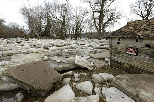 FILE - In this Thursday, March 14, 2019 file photo, thick slabs of ice surround a structure in Fremont, Neb., after the Platte River flooded its banks. (AP Photo/Nati Harnik)