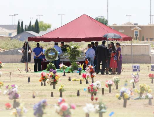 Family and friends gather for a funeral service for Jordan Anchondo at Evergreen Cemetery in El Paso, Texas on Saturday, Aug. 10, 2019. (AP Photo/Jorge Salgado)