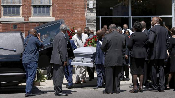 Derrick Fudge's casket is loaded into a hearse on Saturday, Aug. 10, 2019, outside a church in Springfield, Ohio. Fudge, 57, was the oldest of nine who were killed when a gunman opened fire outside a bar early Sunday in Dayton, Ohio. (AP Photo/Angie Wang)
