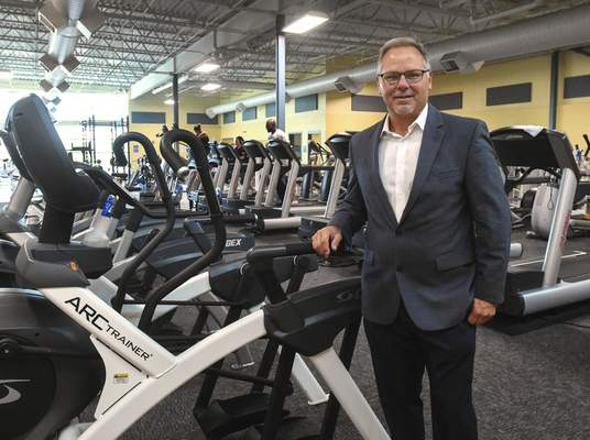 Michelle Davies | The Journal Gazette Marty Pastura, pictured at the Renaissance Pointe YMCA, is stepping down at year's end after 22 years leading the YMCA of Greater Fort Wayne.