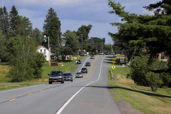 In this Wednesday, July 24, 2019, photo, vehicles head west on route 17B, near the site of the 1969 Woodstock Music and Art Festival in Bethel, N.Y. (AP Photo/Seth Wenig)