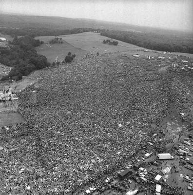 FILE - This Aug. 16, 1969 file photo shows a crowd of about 400,000 people attending the Woodstock Music and Arts Festival in Bethel, N.Y. (AP Photo, File)