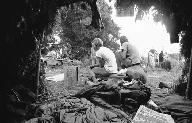 FILE - In this Aug. 16, 1969 file photo, grass and leaf huts are used as makeshift living quarters for some of the attendees at the Woodstock Music and Arts Festival at White Lake in Bethel, N.Y. (AP Photo/File)