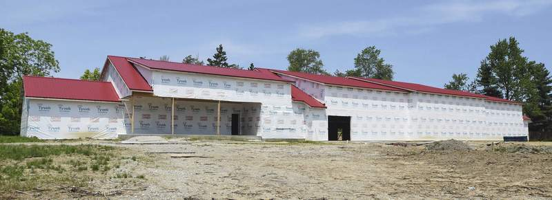 This project at 6626 W. Jefferson Blvd. that morphed from a residence into a giant garage and then a restaurant and retail plaza has changed shape again – this time into a four-unit commercial development. (Michelle Davies | The Journal Gazette)