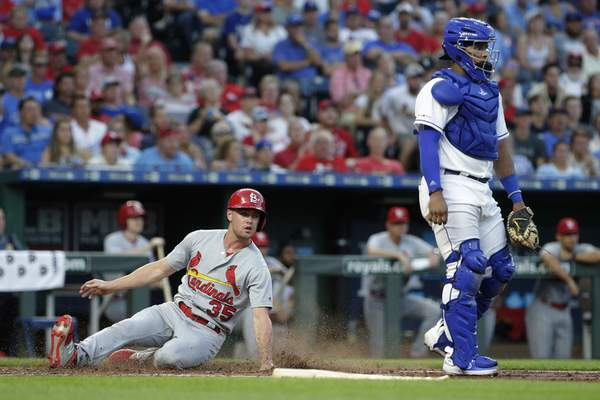 St. Louis Cardinals' Lane Thomas slide home to score on a single by Tommy Edman during the third inning of a baseball game against the Kansas City Royals Tuesday, Aug. 13, 2019, in Kansas City, Mo. (AP Photo/Charlie Riedel)