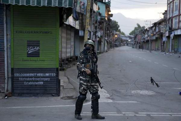 FILE- In this Friday, Aug. 9, 2019 file photo, an Indian Paramilitary soldier patrols during curfew in Srinagar, Indian controlled Kashmir. (AP Photo/ Dar Yasin, File)