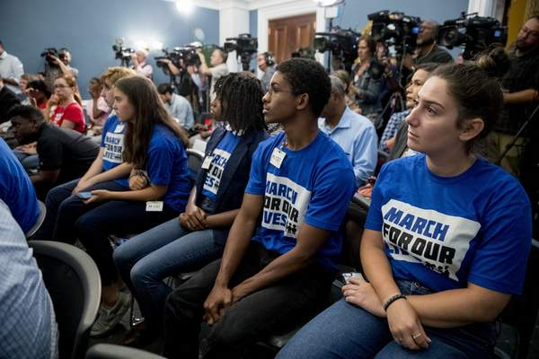 Members of the audience wear March For Our Lives shirts as House Majority Leader Steny Hoyer of Md., Rep. Debbie Dingell, D-Mich., Rep. Anthony Brown, D-Md., and others, hold a news conference calling for Senate action on H.R. 8 - Bipartisan Background Checks Act of 2019 on Capitol Hill in Washington, Tuesday, Aug. 13, 2019. (AP Photo/Andrew Harnik)