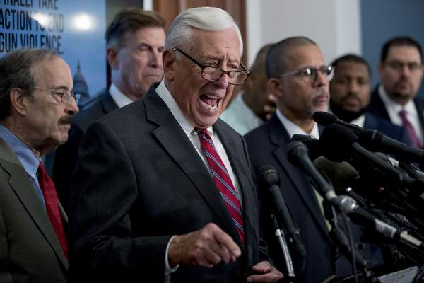 House Majority Leader Steny Hoyer of Md., center, accompanied by Rep. Eliot Engel, D-N.Y., left, Rep. Don Beyer, D-Va., second from left, Rep. Anthony Brown, D-Md., fourth from left, and others, speaks at a news conference calling for Senate action on H.R. 8 - Bipartisan Background Checks Act of 2019 on Capitol Hill in Washington, Tuesday, Aug. 13, 2019. (AP Photo/Andrew Harnik)