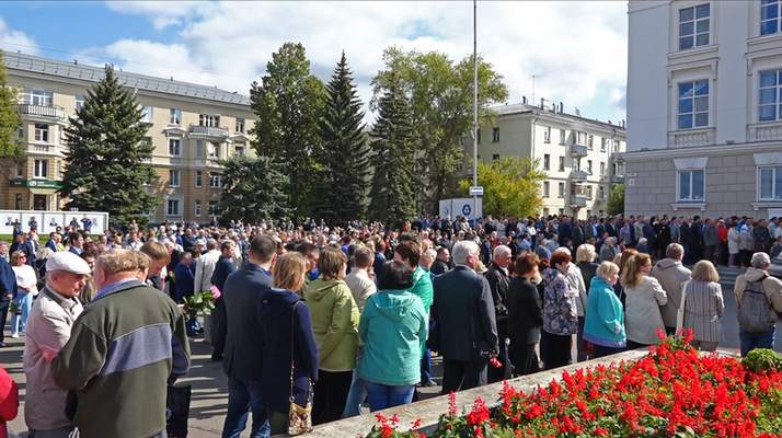In this grab taken from a footage provided by the Russian State Atomic Energy Corporation ROSATOM press service, people gather for the funerals of five Russian nuclear engineers killed by a rocket explosion in Sarov, the closed city, located 370 kilometers (230 miles) east of Moscow, Monday, Aug. 12, 2019. (Russian State Atomic Energy Corporation ROSATOM via AP)