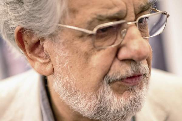 In this Friday, July 12, 2019, photo, Placido Domingo speaks during a news conference about his upcoming show