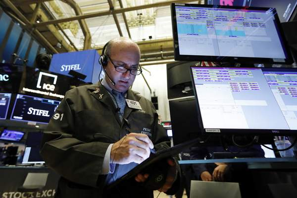 FILE - In this Aug. 6, 2019, file photo trader Andrew Silverman works on the floor of the New York Stock Exchange. (AP Photo/Richard Drew, File)