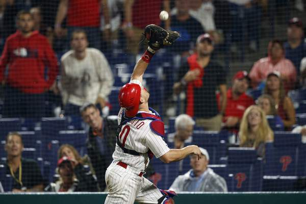 Associated Press Phillies catcher J.T. Realmuto, who homered and the game-winning hit Tuesday, catches a pop foul by Chicago's Albert Almora Jr.