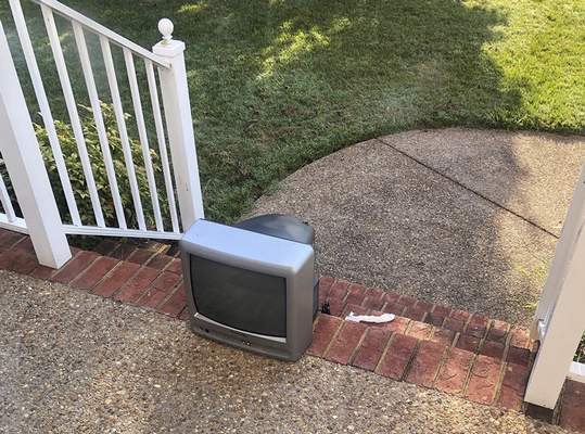 Associated Press A television sitting outside a home is one of dozens that showed up on front porches in Henrico County, Va., this weekend.