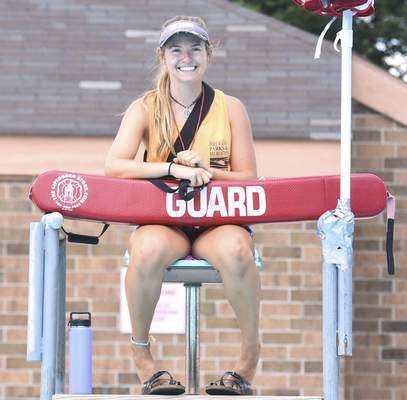 Michelle Davies | The Journal Gazette  Kelsey Peck is the head lifeguard at North Side Pool.