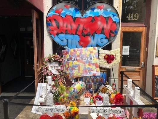 A makeshift memorial sits outside Ned Peppers nightclub in the Oregon District entertainment neighborhood where on Aug. 4 a gunman killed nine people, on Wednesday, Aug. 14, 2019, in Dayton Ohio. (AP Photo/Dan Sewell)