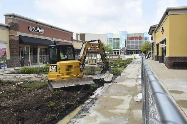 RED Development has started work at Jefferson Pointe to add a street through the heart of the shopping center that will run from the road fronting the theater complex to the fountain. The project is to be finished by mid-2020. (Michelle Davies | The Journal Gazette)