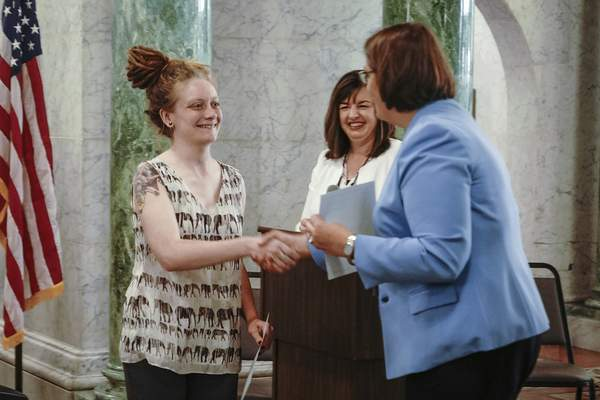 Emily Franks is congratulated by  Allen Superior Court Magistrate Sherry Hartzler after being sworn-in and  receiving a training completion certificate.
