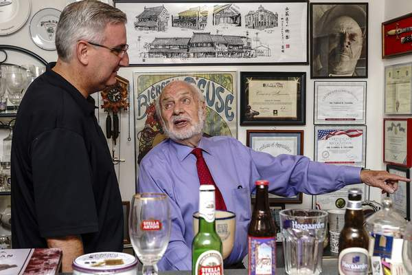 Mike Moore | The Journal Gazette Gabriel DeLobbe highlights some of his life achievements that preceded his Sagamore of the Wabash award presented to him by Gov. Eric Holcomb at DeLobbe's home on Friday.