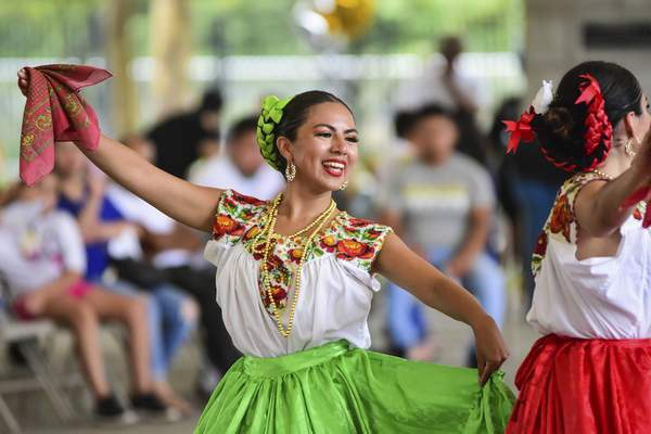 ABOVE: Kaleena Valdez, with the Academy of Mexican Dance & Music in Chicago, performs Saturday. Along with folkloric dancers, the festival featured live music, piñatas, mariachi bands, food, games and information booths.