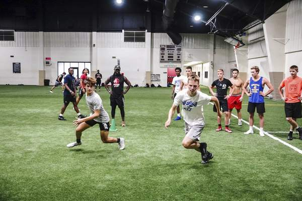 Mike Moore   The Journal Gazette Traction Athletic Performance coach Laurence Barnett, center, works with athletes to improve their footwork and speed at the Summit.