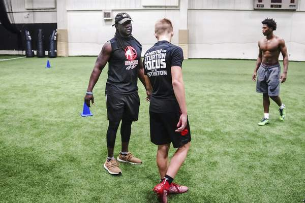 Mike Moore   The Journal Gazette Traction Athletic Performance coach Laurence Barnett critiques a students form at the Summit on Wednesday 07.31.19