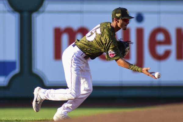 Mike Moore | The Journal Gazette  TinCaps shortstop Tucupita Marcano made an incredible play in the eighth inning Monday, but the TinCaps lost 4-3 to the Bowling Green Hot Rods.