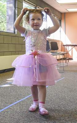 Michelle Davies | The Journal Gazette Emerson Kay, 3, of Fort Wayne works on her princess walk during Monday morning's Princess Tea Party at the Fort Wayne Parks and Recreation Department Community Center.