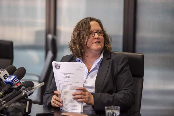 Complainant's lawyer Vivian Waller talks at a press conference after Cardinal George Pell's appeal at the Supreme Court in Melbourne, Australia, Wednesday, Aug. 21, 2019. (AP Photo/Andy Brownbill)