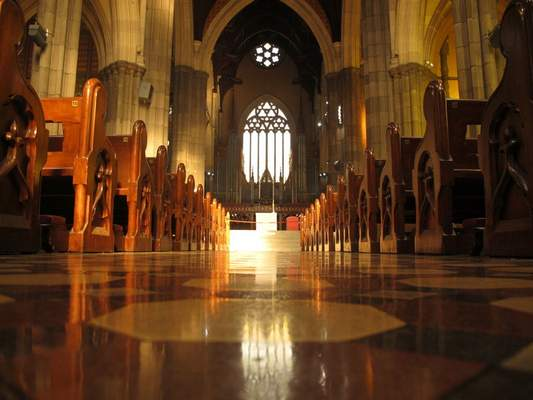 FILE - In this Sept. 9, 2018, file photo, pews line the shiny isle inside the St. Patrick's Cathedral in Melbourne. (AP Photo/Rod McGuirk, File)