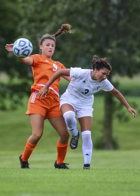 Mike Moore | The Journal Gazette  Northrop's Janel Jordan, left, and Bishop Dwenger's Callie Burns fight for possession of the ball in the first period during the SAC Soccer Jamboree at Kreager Park on Saturday.
