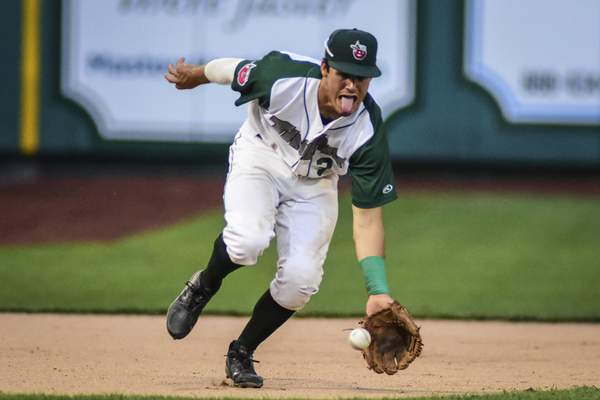 Mike Moore | The Journal Gazette TinCaps third baseman Ethan Skender scoops up a ground ball in the fourth inning against Bowling Green at Parkview Field on Tuesday.