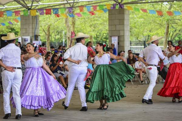 Mike Moore | The Journal Gazette  Entertainers with the Academy of Mexican Dance & Music in Chicago perform a traditional Costa Chica of Guerrero dance in front of guests attending the Fiesta Fort Wayne event held at Headwaters Park on Saturday.