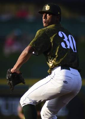 Mike Moore | The Journal Gazette TinCaps pitcher Edwuin Bencomo pitches in the first inning against Bowling Green at Parkview Field on Monday.