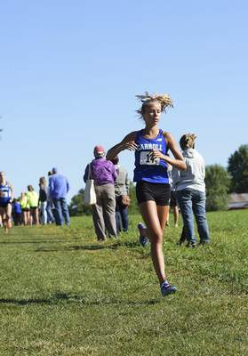 Katie Fyfe | The Journal Gazette Carroll's Zoe Duffus finishes in second place during the Huntington North Invite at the Huntington University cross country course in Huntington, Indiana on Saturday.