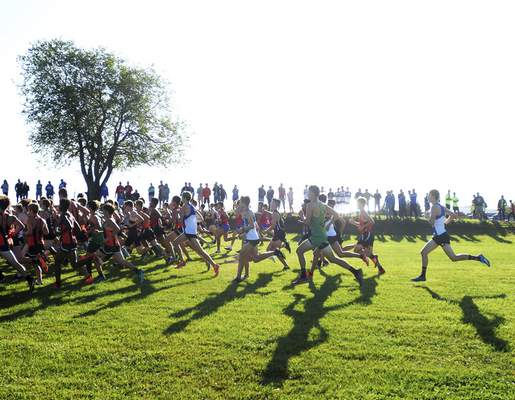 Katie Fyfe | The Journal Gazette The boys varsity runners begin the race during the Huntington North Invite at the Huntington University course in Huntington, Indiana on Saturday.