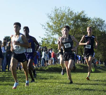 Katie Fyfe | The Journal Gazette  Reece Gibson, Izaiah Steury, Cole Kimmel, and Paul Stamm take the lead early on during the Huntington North Invite at the Huntington University cross country course in Huntington, Indiana on Saturday.