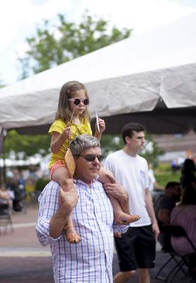 Katie Fyfe | The Journal Gazette  Charles Shepard and Louisa Shepard, 3, enjoy the Taste of the Arts Festival together on Saturday.