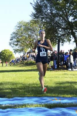 Katie Fyfe | The Journal Gazette Bishop Dwenger's Erin Strzelecki finishes in first place Saturday at the Huntington North Invitational at the Huntington University cross country course in Huntington.