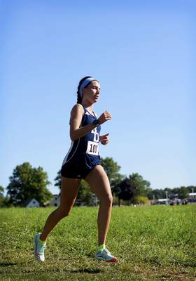 Katie Fyfe | The Journal Gazette  Bishop Dwenger's Erin Strzelecki finishes first place in girls varsity during the Huntington North Invite at the Huntington University cross country course in Huntington, Indiana on Saturday.