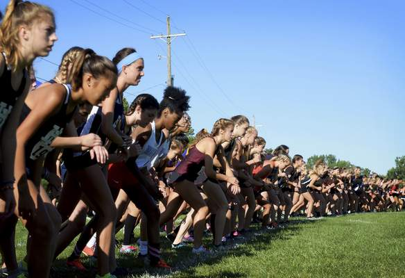 Katie Fyfe | The Journal Gazette  The girls varsity runners line up to begin the race during the Huntington North Invite at the Huntington University cross country course in Huntington, Indiana on Saturday.