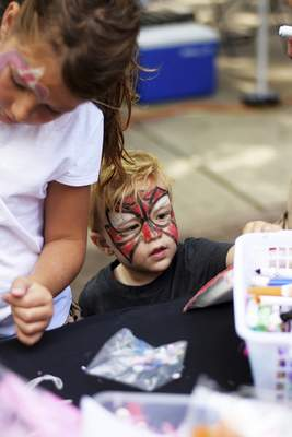 Katie Fyfe | The Journal Gazette  Issac Murphy, 2, works on some paper plate art during the Taste of the Arts Festival on Saturday.