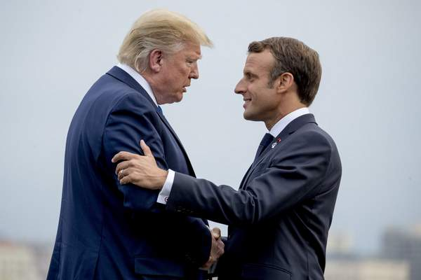 Associated Press President Donald Trump and French President Emmanuel Macron greet each other at the G-7 summit Saturday in Biarritz, France.